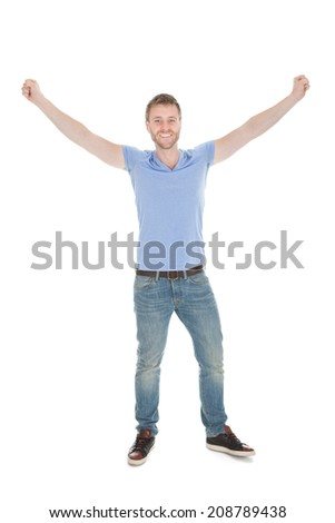 Portrait of cheerful young man with hands raised standing isolated on white background - stock photo