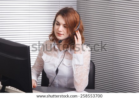 Portrait of cheerful young support phone operator in headset - stock photo