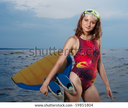 Portrait of cheerful young woman. Free Diver at sea.