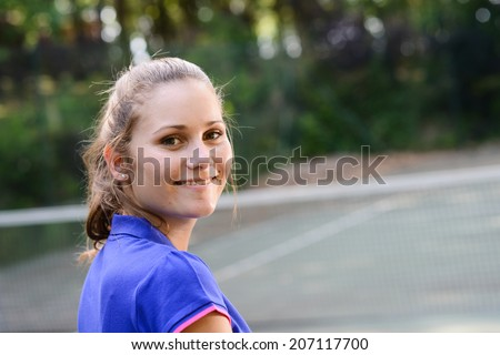portrait of cheerful young woman playing tennis outdoor in summer - stock photo