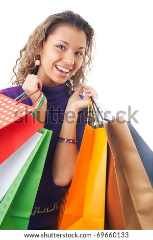 Portrait of  cheery young woman with shopping bags
