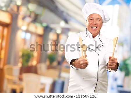 Portrait Of Chef While Holding Spoon, Outdoor - stock photo