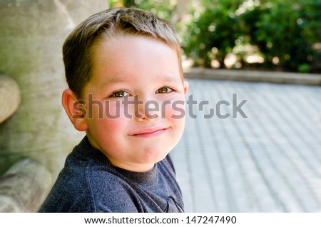 Portrait of child at city park - stock photo