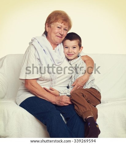 portrait of child boy and grandmother on white, happy family concept - stock photo