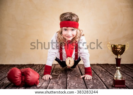 Portrait of child businessman in office. Success, leader and winner kid - stock photo