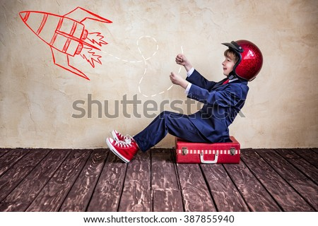 Portrait of child businessman with suitcase. Start up business concept - stock photo