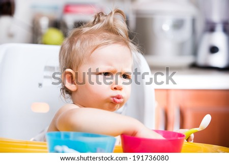 Portrait of child girl on kitchen. Use it for child, healthy food, infant formula concept - stock photo