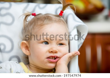 Portrait of child girl on kitchen. Use it for child, healthy food, infant formula concept