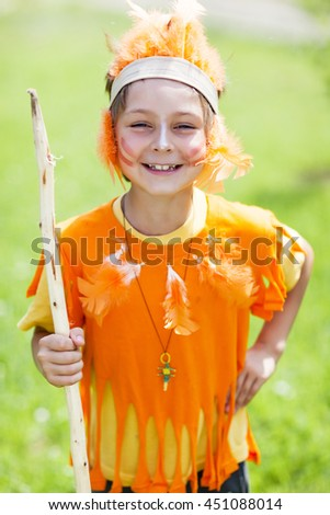 Portrait of child in the costume of indian - stock photo
