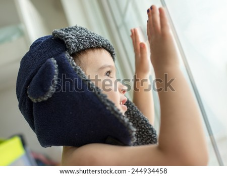 Portrait of child on window - stock photo