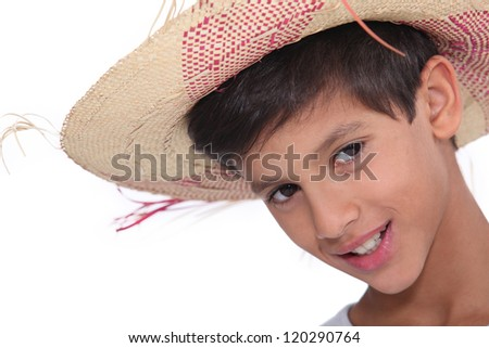 Portrait of child wearing a hat - stock photo