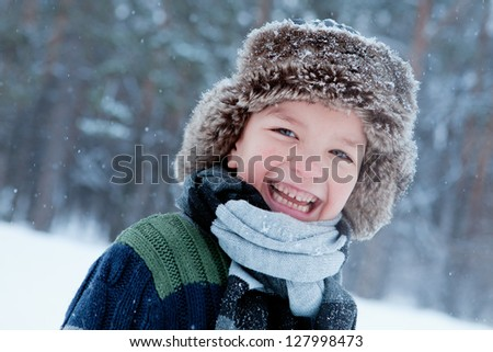 Portrait of child wearing scarf, winter