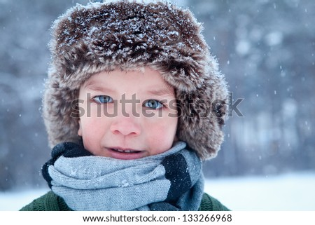 Portrait of child wearing scarf, winter - stock photo