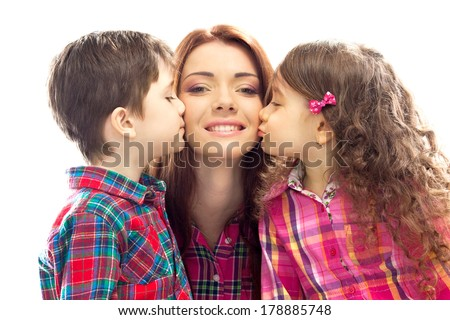 Portrait of children kissing her mother with flowers. Mothers day concept. Family holiday. Isolated white background - stock photo