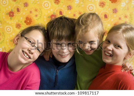 Portrait of children on a yellow floral backgound