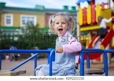 Portrait of children on the Playground - stock photo