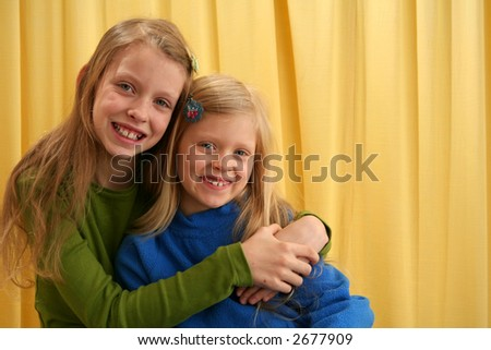 Portrait of children on yellow background - stock photo