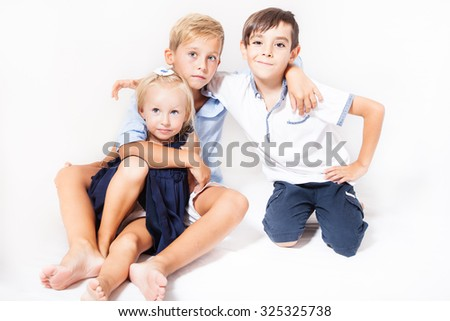 Portrait of children: two boys with one girl - stock photo
