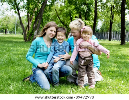 Portrait of children with their mother and grandmother in the park
