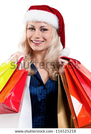 Portrait of Christmas woman in santa hat holding shopping bags on white background - stock photo