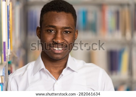 Portrait Of Clever Black Student In College Library - Shallow Depth Of Field