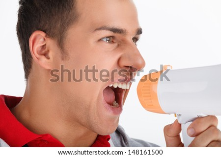 Portrait of coach with megaphone. Coach shouting in megaphone - stock photo