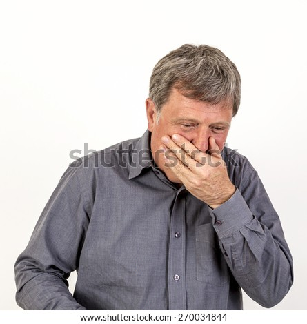 portrait of coffing mature man with grey polo shirt - stock photo