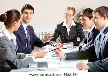 Portrait of colleagues planning their work and discussing it in office - stock photo