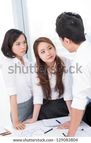 Portrait of colleagues working together - stock photo
