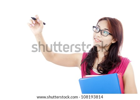 Portrait of college student holding documents and use marker to write something on a space - stock photo