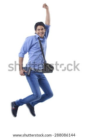 Portrait of college student jumping - stock photo