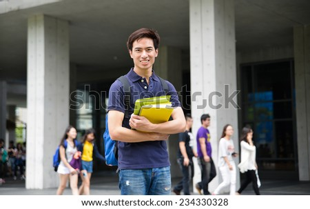 Portrait of college student standing at his university - stock photo