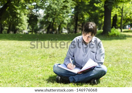 Portrait of college student with notebook. Education concept.