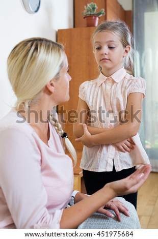 Portrait of concerned woman and child with abdominal pains