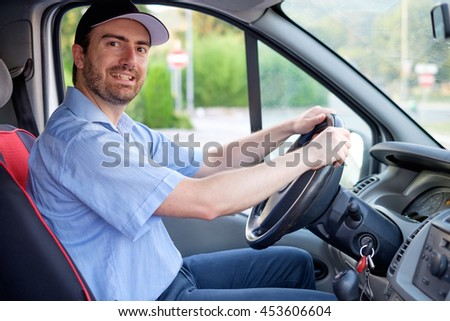Portrait of confidence express courier driving his delivery van