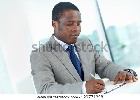 Portrait of confident African businessman working in office - stock photo
