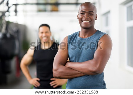 portrait of confident african male gym trainer  - stock photo