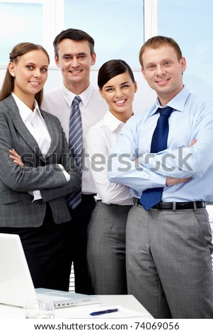 Portrait of confident business group looking at camera