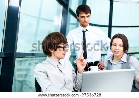 Portrait of confident business man explaining a project to colleagues at the office. Lots of copyspace - stock photo