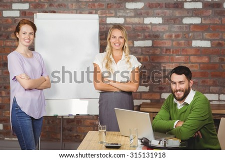 Portrait of confident business people in creative office - stock photo