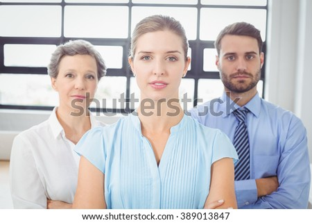 Portrait of confident business people standing in office