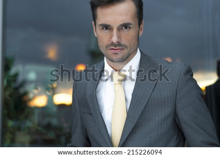 Portrait of confident businessman in office - stock photo