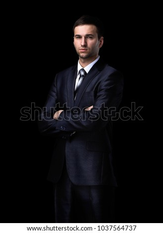 portrait of confident businessman,isolated on a black