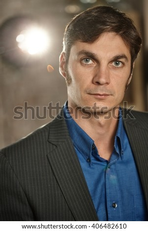 Portrait of confident businessman looking at camera. - stock photo