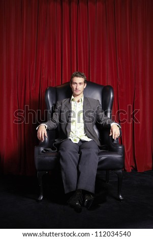 Portrait of confident businessman sitting on couch