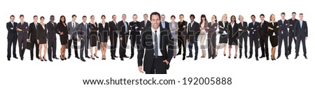 Portrait of confident businessman with team standing against white background