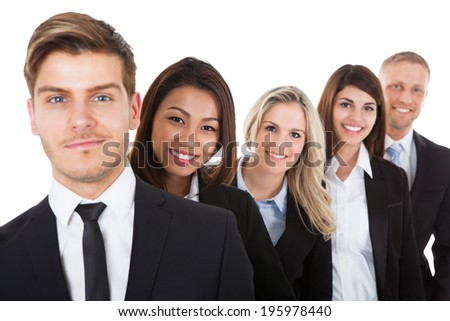 Portrait of confident businesspeople standing in a row against white background