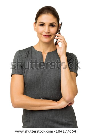 Portrait of confident businesswoman answering smart phone against white background. Vertical shot. - stock photo