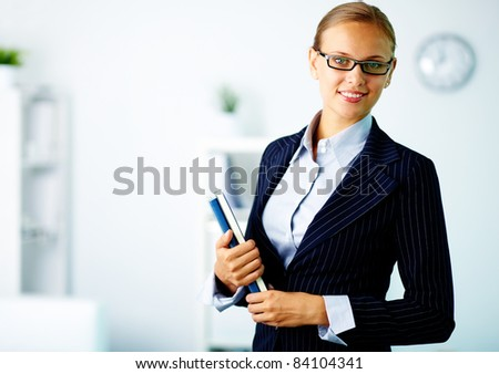 Portrait of confident businesswoman looking at camera in office - stock photo