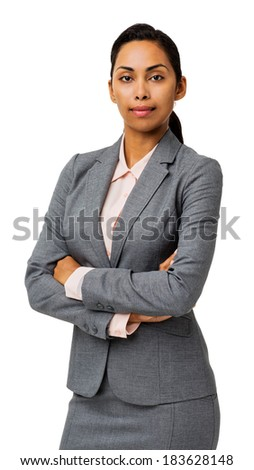 Portrait of confident businesswoman with arms crossed standing against white background. Vertical shot.